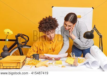 Serious Mixed Race Female Coworkers Enjoy Collaboration Meeting Creat Business Project Together Have