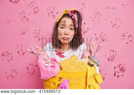 Clueless Puzzled Asian Housewife Spreads Palms Feels Hesitant Busy Doing Laundering At Home Wears Pr
