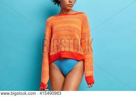 Rear View Of Slim Woman Wears Long Sleeved Orange Jumper And Panties Has Long Legs Fit Smooth Skin F