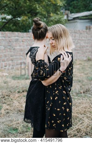 Lgbt Lesbian Couple Love Moments Concept. Two Young Lesbians Girls Hugging And Walking Outdoors. Hap