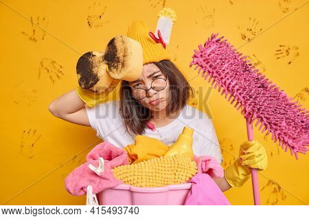 Exhausted Tired Young Asian Woman Wipes Sweat From Forehead Feels Tired After Wiping Walls Of Apartm