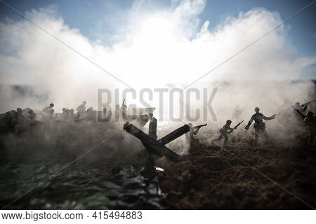 World War 2 Reenactment (d-day). Creative Decoration With Toy Soldiers, Landing Crafts And Hedgehogs