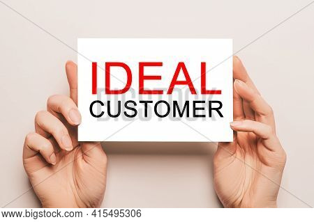 Female Hands Hold Card Paper With Text Ideal Customer On A Yellow Background. Business And Finance C