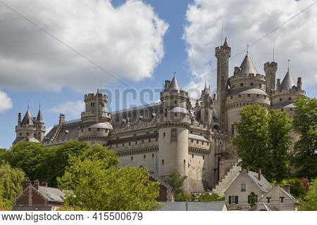 Pierrefonds, France - May 25 2020: The Castle Of Pierrefonds Is An Imposing Castle Located On The So