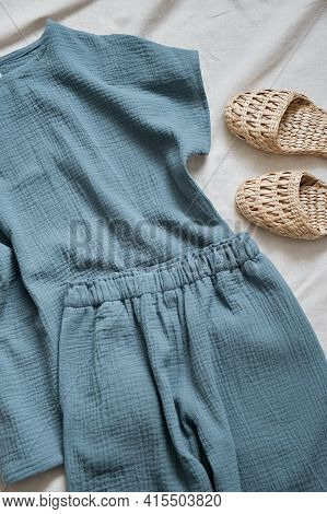 Muslin Pajamas Made Of A Blouse And Trousers In A Beautiful Blue Color. Nearby Are Comfortable And S
