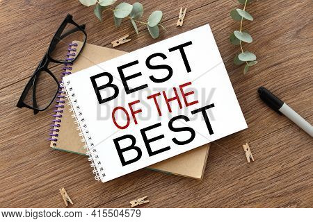 Best Of The Best. Text On White Paper On Wood Table Background