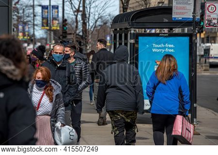 Chicago, Il March 14, 2021, People Shoppers Walking Down The Sidewalk On Michigan Avenue Wearing Mas