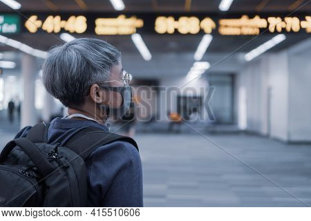 Smart Asian Woman With Glasses And Face Masks Prevent Covid-19 Virus Disease At Airport Terminal For