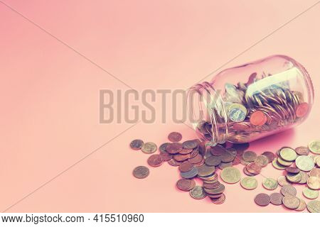 Glass Jars With Coins On Pink Background, Coins Spilling Out Of A Glass Jar Tipped On Its Side, Savi