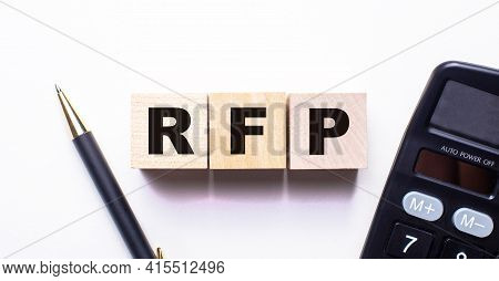 The Words Rfp Request For Proposal Is Written On Wooden Cubes Between A Pen And A Calculator On A Li