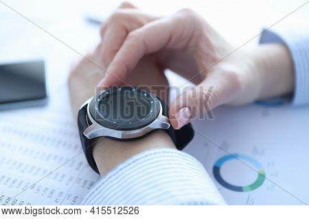 Smart Watch With Black Bracelet On Womans Hand