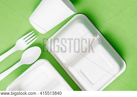 Eco Friendly Biodegradable Paper Disposable For Packaging Food On Green Background.