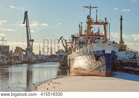 Moored Cargo Ships And Harbor Cranes In Port. Seaport, Cargo Container Yard, Container Ship Terminal