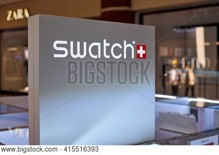 Russia, Kaliningrad - 02.15.2021 - Swatch, Sign With Logo Lettering Of Swiss Watches At Store Displa