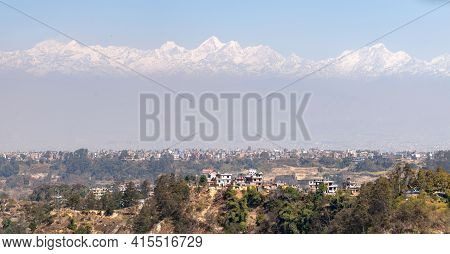 Himalaya Mountains With City In Foreground
