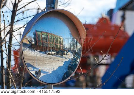 Mirror Of Spherical Type On Telegraph Pole Reflecting Road. Large Convex Mirror On Road For Improvin