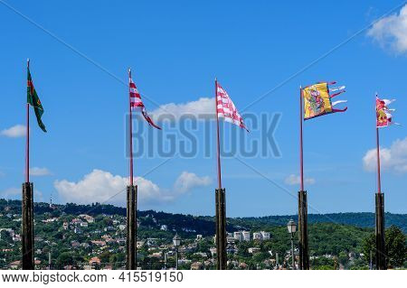 Many Vivid Colorful Flag Blowing In The Wind In Direct Sunlight Towards Clear Blue Sky In A Sunny Da