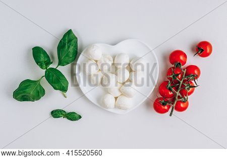 Composition With Fresh Basil, Dough, Mozzarella, Olive Oil. Ingredients For Italian Cuisine Isolated