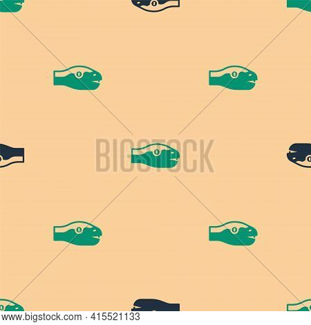 Green And Black Snake Icon Isolated Seamless Pattern On Beige Background. Vector