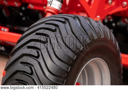 Close Up View Of New Black Wheel And Clean Protector On Tractor Tire. Concept Of Agricultural Machin