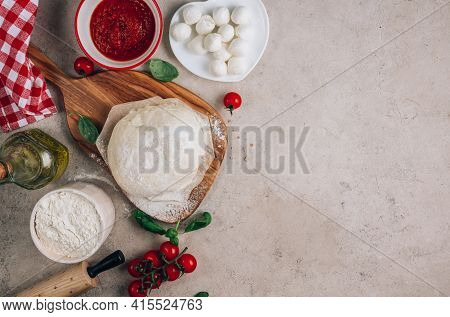 The Ingredients For Homemade Margherita Pizza On Stone Background.