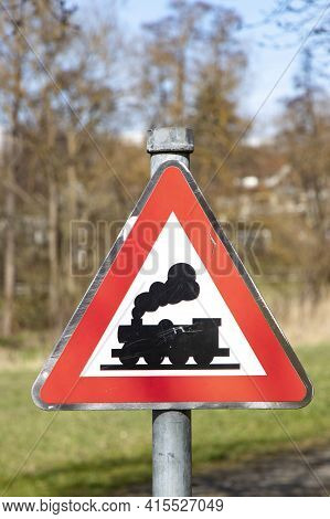 Railroad Level Crossing Sign Without Barrier Or Gate Ahead The Road, Beware Of Train Roadside Steam