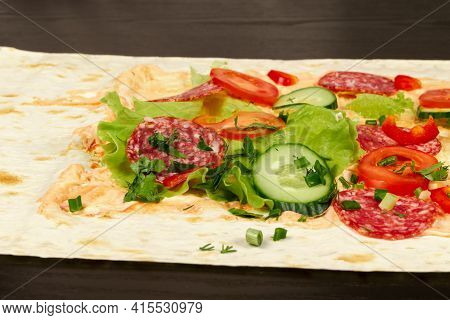 Ingredients For Shawarma Are Laid Out On A Thin Pita Bread. Tomatoes, Greens, Salami, Cheese, Cucumb