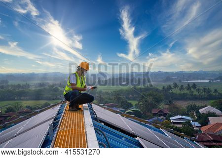 Solar Cells, Technician Use A Tablet Working At Solar Power Station On Roof, Solar Energy,