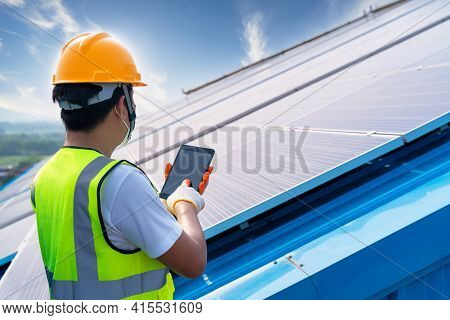 Engineering Use A Tablet Working On Roof Checking And Maintenance In Solar Power Plant , Solar Power