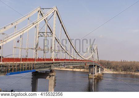 Kyiv, Ukraine- April 1, 2021: Pedestrian Bridge On Trukhanov Island. Walking Along The Pedestrian Zo