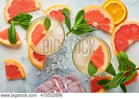 Lemonade Drink Made From Grapefruit, Soda Water And Mint Leaves With Ice On Light Blue Slate, Stone