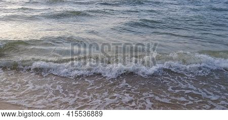 Natural Background: Light Sea Waves Roll Ashore