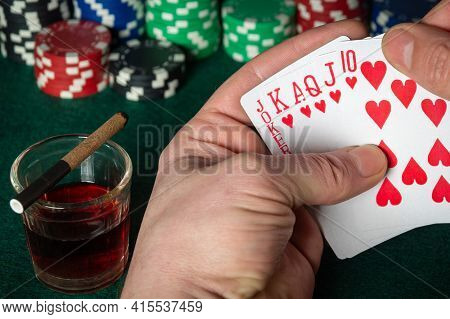 Poker Cards With A Winning Combination. Close Up Of A Gambler Hand Is Holding Playing Cards In Poker