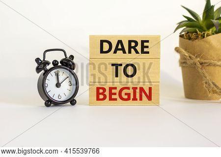Dare To Begin Symbol. Wooden Blocks With Words 'dare To Begin'. Beautiful White Background, Black Al