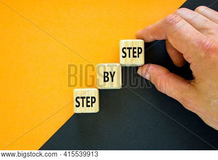 Step By Step Symbol. Hand Arranging Wood Block Stacking As Step Stair On Top With Words Step By Step