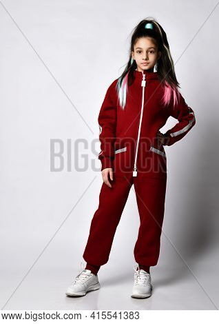 Caucasian Girl Model Preteen Pretty With Fashionable Hairstyle Wore Sports Clothes, Posing For The C