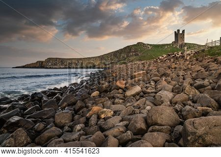 Beautiful Landscape Image Of Dunstanburgh Castle On Northumberland Coastline In England During Late