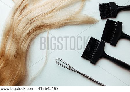 A Broom And A Brush For Dyeing Hair On A White Background. Hair Coloring Concept And Parekmahep Inst