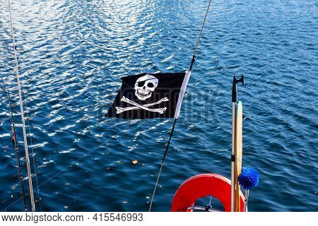 Oslo, Norway - September, 2019: Pirate Sign Called Jolly Roger On Sailboat Flag.white Skull With Cro