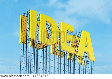 Large Yellow Signboard On Metal Frame With The Word Idea. Clear Sky In The Background. Concept Of In