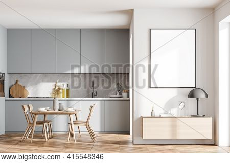 Bright Cozy Kitchen Room Interior With Dining Table, Cupboard, Empty White Poster On The Wall, Oak W