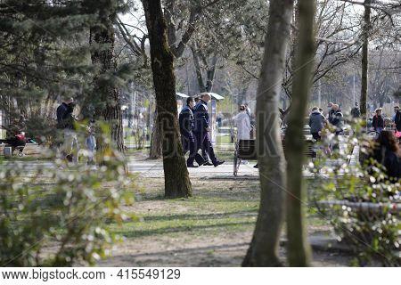 Bucharest, Romania - March 28, 2021: Romanian Policemen Patrol The Ior Park In Bucharest During Covi