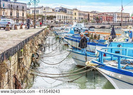 Syracuse Sicily/ Italy -january 24 2017: Fisherman On The Fishing Boat
