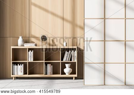 Living Room Interior With Bookcase Full Of Books And Vases Located On Concrete Floor. Concept Of Hom