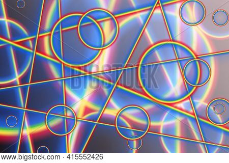 Rainbow Circles And Lines Intersect And Overlap On A Gray Background. Abstract Background With Lines