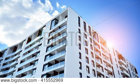 Facade Of A Modern Apartment Building. Glass Surface With Sunlight. Modern Apartment Buildings On A