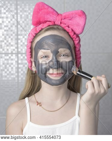Girl With A Cleansing Mask On Her Face. Home Skin Care.