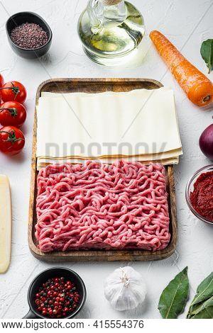 The Concept Of Cooking Lasagna. Ingredients, Lasagna Sheets, Basil, Cherry Tomatoes, Parmesan, Garli