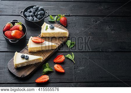 Classic New York Cheesecake, Sliced, On Black Wooden Table Background With Copy Space For Text