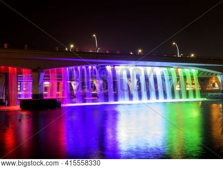 Dubai, Uae 6th Nov 2020 -colorful Illuminated Dubai Canal Boardwalk Waterfall In Dubai. The Waterfal